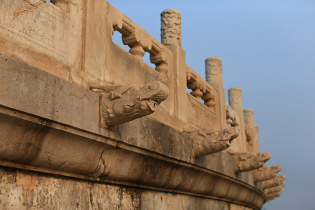 Dragons head drainage pipes from a stone balcony. Taken at the Temple of Heaven in Beijing, the famous attraction ,China. 写真素材