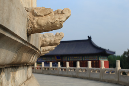 Dragons head drainage pipes from a stone balcony. Taken at the Temple of Heaven in Beijing, the famous attraction ,China. 報道画像