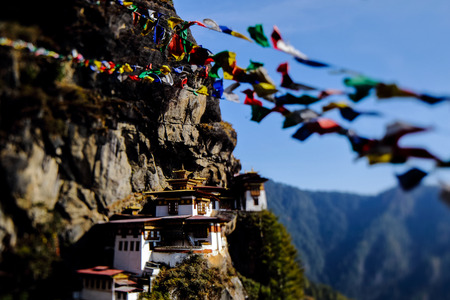 Landscape of Paro Taktsang (Tiger Nest) in Upper Paro Valley, Bhutan. Taktsang Lhakhang is Bhutan most iconic landmark and religious site. foreground prayer flag five color. focus only temple 写真素材