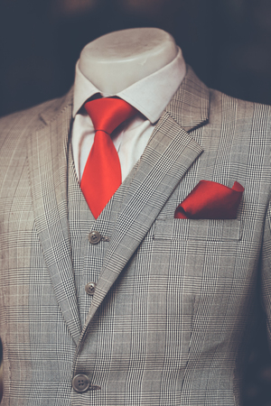 Work in Progress Suit without sleeve on Mannequin red necktie with Dark background