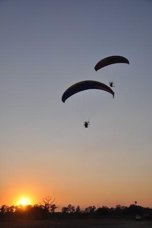 Paramotors at sunset photo