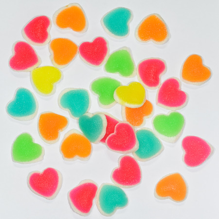 colorful heart sign jelly on white background