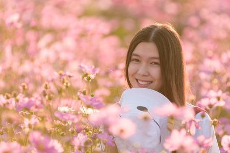 Beautiful Asian girl smiling in pink cosmos flower field Stok Fotoğraf