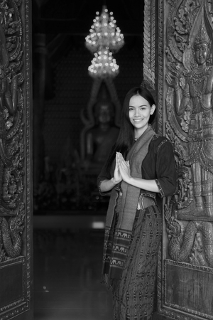 Asian woman wearing typical (Traditional) Thai dress in temple