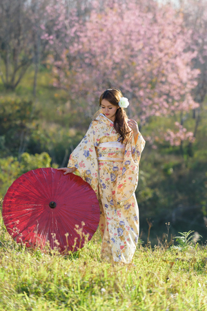 portrait of asian traditional woman with flower