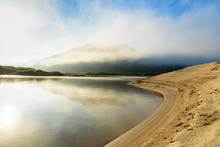 beautiful curve river with mountain cloudy fog and blue sky background at sunrise Stok Fotoğraf