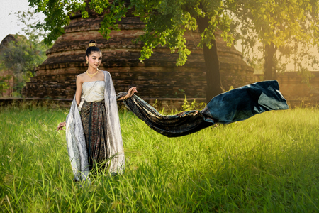 portrait of beautiful Thai girl in tradition dress with beautiful sunlight and pagoda background in temple of Ayutthaya Thailand (with oilpaint filter) Stok Fotoğraf - 62245616