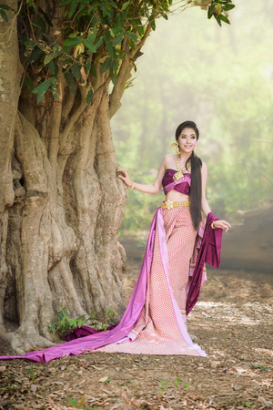 Asian woman wearing typical (Traditional) Thai dress with forest background Stok Fotoğraf