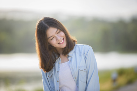 beautiful girl portrait during sunset smiley happy with nature background Stok Fotoğraf