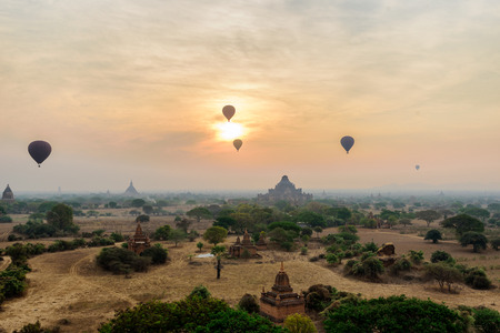 many hot air balloons above Bagan in old Bagan  Mandaly Myanmar, an ancient city with thousands of historic buddhist temples and pagoda Stok Fotoğraf - 72751846