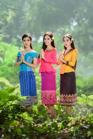 beautiful Asian women (Laos)  in traditional costume with stunning light and nature background Stok Fotoğraf