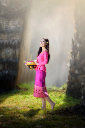 beautiful Asian women (Laos)  in pink traditional costume with stunning light background Stok Fotoğraf - 71441864