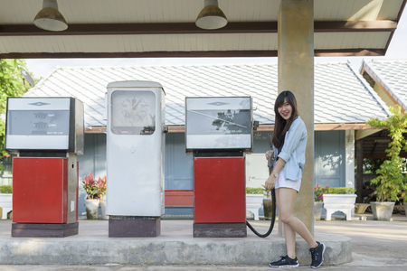 Portrait of  asian woman at vintage gas station