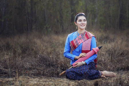 beautiful girl in Thai traditional costume with red umbrella Stok Fotoğraf