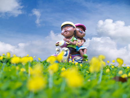 Baked clay doll riding motorcycle on pinto peanut fiels  Arachis pintoi Stock Photo - 26141076