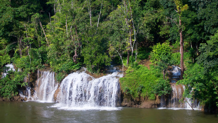 Sai Yok Yai waterfall flows directly into Khwae Noi River, Sai Yok National Park, Kanchanaburi, Thailand photo