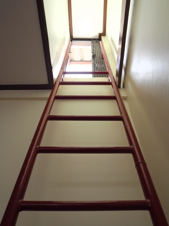 room door: Red ladder to door from underground room