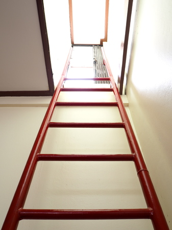 attic: Red ladder to door from underground room