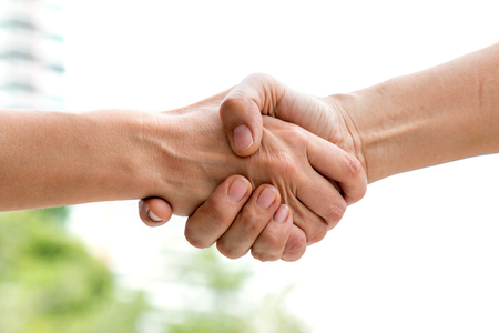 Close up of handshake of business partner after agreement