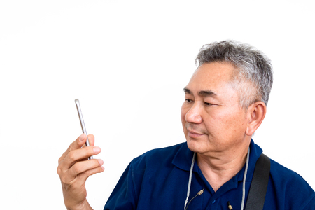 Old Asain man look at mobile phone on white background