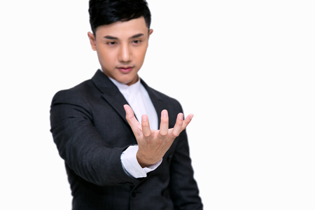 Young businessman holding some thing in his hand;Standing on white background