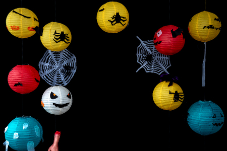 Halloween lantern in many kind of mask and colour on black background Stock Photo