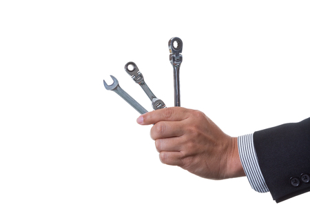 Mechanic engineer holding two ratchet box end wrench and open end wrench in his hand; handing tool on white background with clipping path