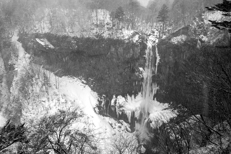 Kegon Fall is frozen during strong snowfall in winter season of Japan; Low contrast by black and white tone