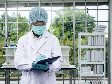 Portrait of Senior scientist with formal uniform and working in laboratory Stock Photo