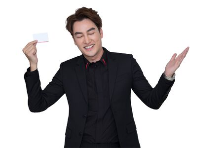 Senior Asian manager in black suit holding white card  with happiness on white background with clipping path