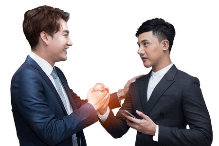 Two businessmen shaking hand together on white background with clipping path; cooperation business with partnership