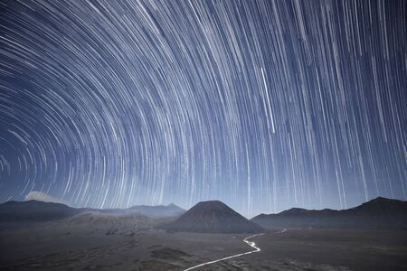 Star tail as light line on night sky by star stax over Bromo volcano from multi shooting picture 写真素材