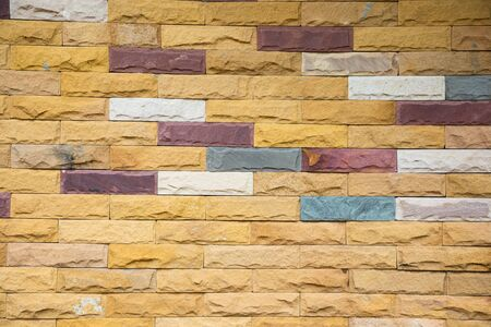 Rectangle brick block wall background and texture. Painted in red, brown and grey color