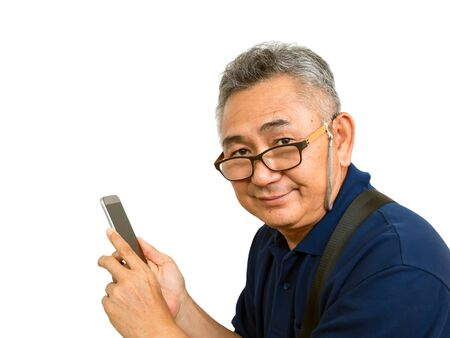 Old Asain man holding mobile phone and smiling on white background with clipping path