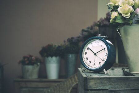 Close up of Clock placing near rose bucket and show time at 10 with copy space