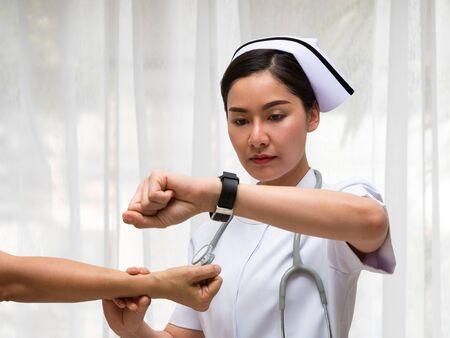 Asian Nurse check Male Patient Blood Pressure Pulse