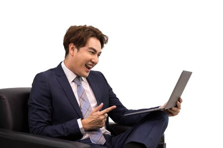Senior businessman feeling happiness after check email from laptop while sitting on sofa on white background