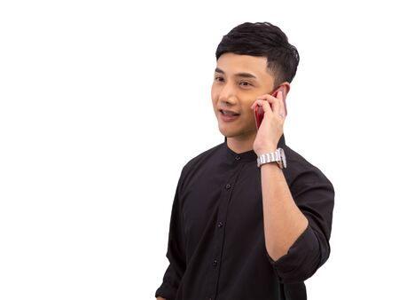 Young Asian businessman in black shirt talking through mobile phone on white background with clipping path