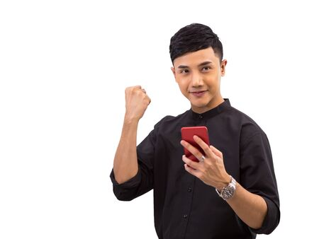 Young Asian businessman in black shirt holding mobile phone and feeling happiness on white background with clipping path