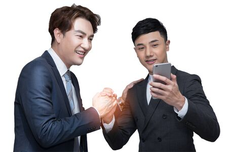 Two businessmen shaking hand and taking picture together on white background with clipping path; cooperation business with partnership