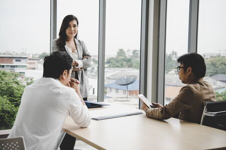 Sale woman prepare for summary report to manager and director in meeting room