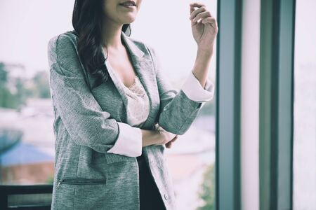 Close up of Sale woman standing with confidence in meeting room Banco de Imagens