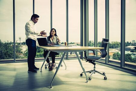 Manager Claiming to Businesswoman at Office; Business stress concept