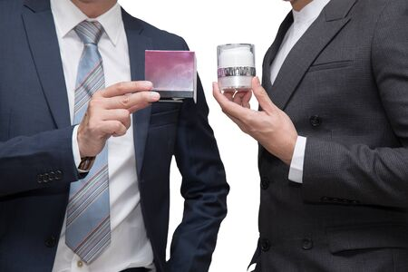 Two businessmen holding beauty product together on white background