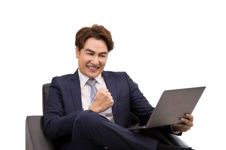 Senior businessman feeling happiness after check email from laptop while sitting on sofa on white background Banco de Imagens