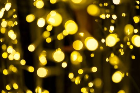 Golden Lighting and decoration item for Christmas and New Year Celebration; Blurry Abstract concept