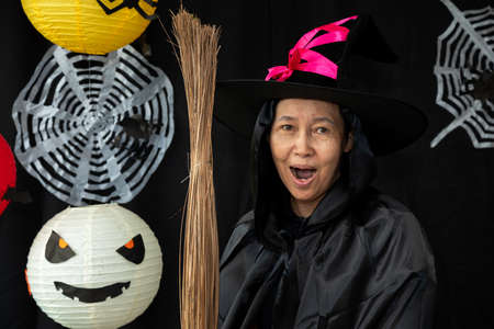 Old witch Halloween woman portrait. Sorcerer makeup with Fashion art design as attractive model in Halloween costume