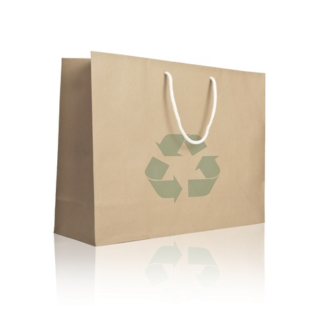 Recycle paper shopping bag on reflect white floor  Stock Photo