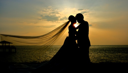 Silhouette of couple in love at sunset  photo