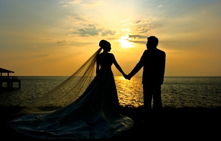 Romantic silhouette of wedding couple at sunset  Stock Photo
